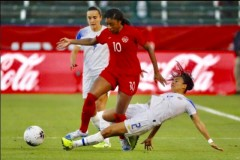 Canada defender Ashley Lawrence left, fends offf a chellenge against Costa Rica: Getty