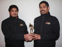 Kamlesh Krishna (L) accepts the 2014 Sportsone Sports Personality of the Year award from Sportsone's Sunil Sharma.