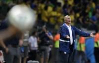Brazil coach Luiz Felipe Scolari watches his side crumble against Germany