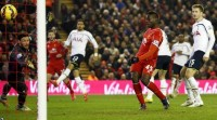 Mario Balotelli's first Premier League goal for Liverpool earns his side a 3-2 victory at home against Tottenham.