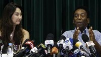 Pele with his girlfriend during a press conference in Sao Paulo.